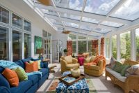 traditional sunroom design with two conversation zones