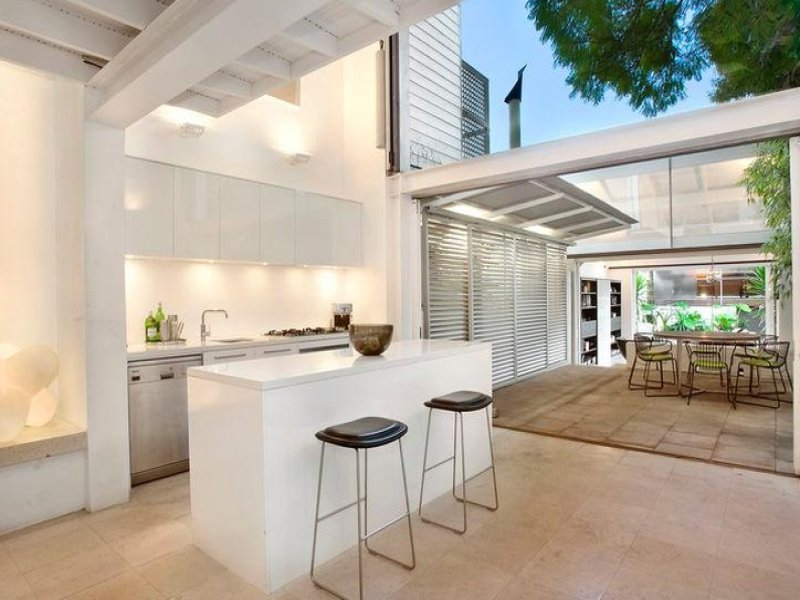 Light and airy tropical house without indoors outdoors for Indoor outdoor kitchen designs