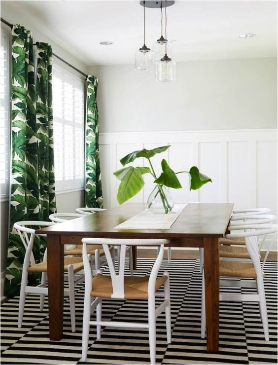tropical-inspired dining area with Stockholm rug