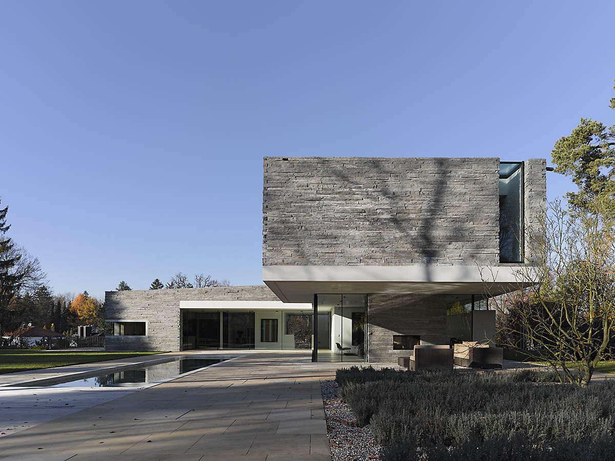 Two-Story House with Rough Stone Facade – House M | DigsDigs