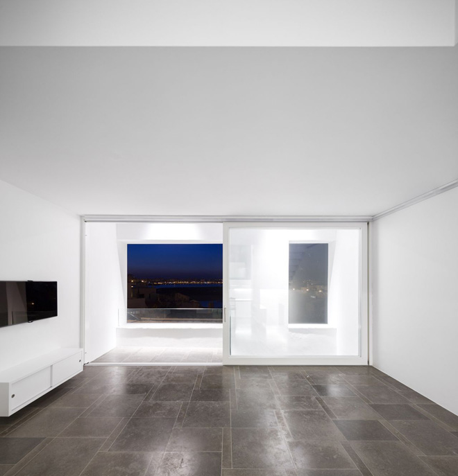 ultra minimalist house with living behind the walls