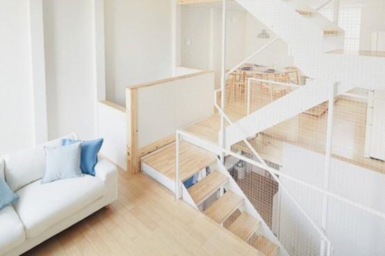 Ultra minimalist white house on a narrow lot digsdigs for Minimalist narrow house