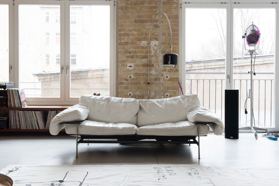 Picture Of uncluttered artists loft in neutral colors  10