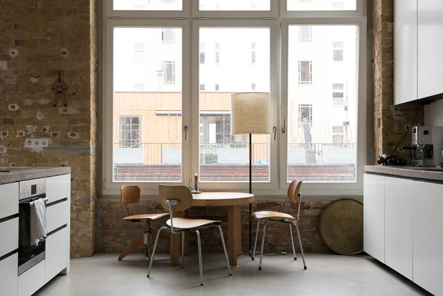 Picture Of uncluttered artists loft in neutral colors  8