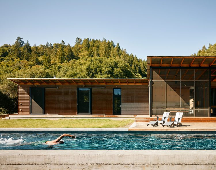 Uncluttered Poolside Home Opened To Outdoors