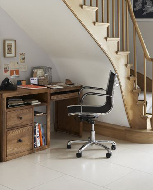 Organizing a home office under stairs is definitely a space saving idea.