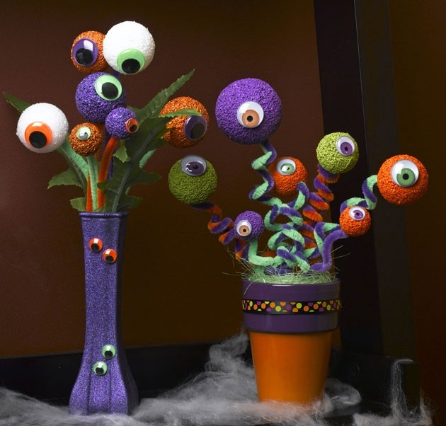a purple and orange vase with bold eyeball bouquets is a creative and fun decoration for Halloween