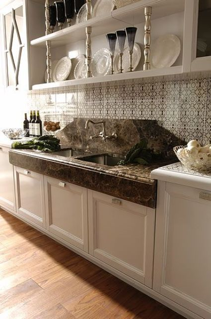 elegant white cabinets with dark stone countertops look very chic and vintage meets contemporary