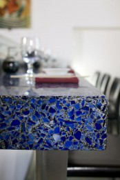 a bold blue mosaic coutertop with a touch of sparkle is a cool idea for a modern space