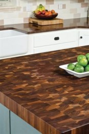 a rich stained butcherblock countertop is a stylish idea for a rustic kitchen with white and aqua cabinets