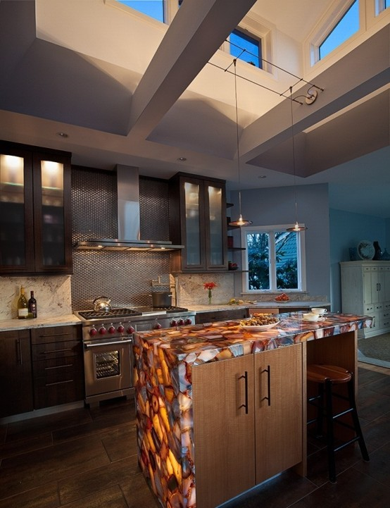 rich stained and light stained cabinets with an onyx coutnertop with built-in lights to accent the countertop even more