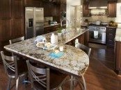 dark stained wooden cabinets and grey stone countertops create a stylish combo for an elegant kitchen with a rustic feel