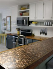 a penny countertop looks bold, cool and can be DIYed of coins and epoxy by you yourself