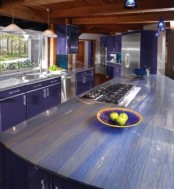 purple cabinets and striped purple and neutral stone countertops for a bright and colorful kitchen look