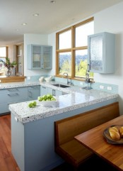 light blue cabinets and matching terrazzo countertops plus a matching tile backdsplash for a dreamy and tender kitchen