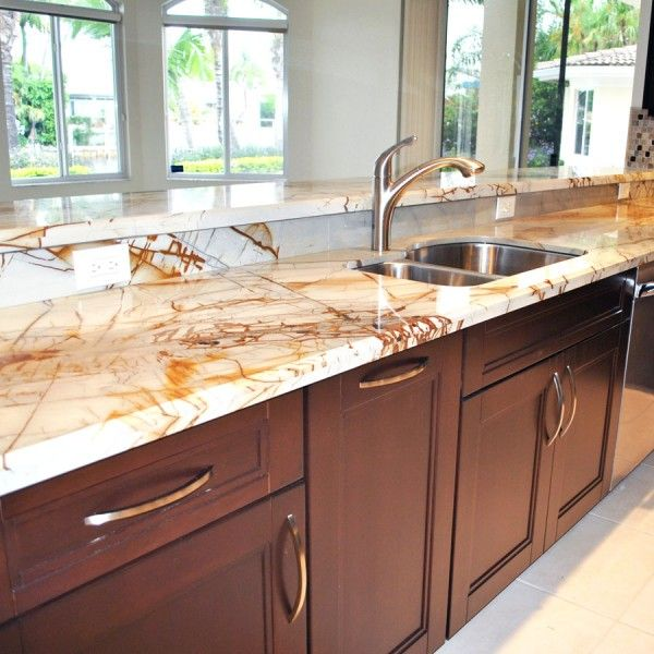 rich stained wooden cabinets with neutral stone countertops that create a bold contrasting look