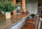 a neutral kitchen island with a natural stone countertop with a rough edge looks rustic and relaxed
