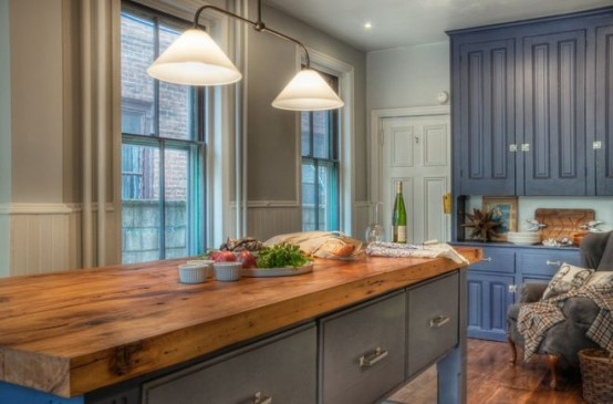 a vintage grey kitchen island with a butcherblock countertop for a contrast and a bold look
