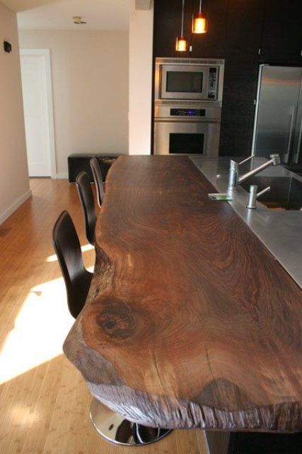 a rich stained wooden countertop with a living edge is a chic idea with a modern feel
