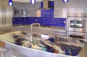 a colorful epoxy countertop that matches bright colors of the backsplash and features even more shades with watercolors