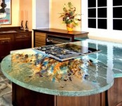 a bright aqua countertop with colorful watercolors looks very artful and bold