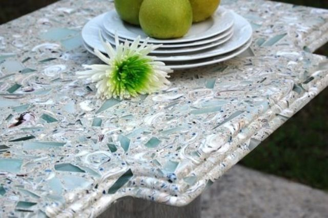 a mosaic countertop in grey and aqua colored glass is a stylish and bright idea for home decor