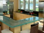 a blue glass countertop is a modern idea for a kitchen, though it's not very durable, it's stylish