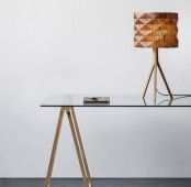 a stylish table lamp with a geometric faceted lampshade and a simple wooden base for adding a natural touch to the space
