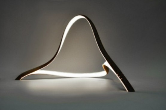 a creative curved LED lamp is a perfect fit for a modern or minimalist space that will bring a shape to the space
