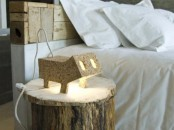 a plywood animal-shaped lamp that reminds of some pig is a fun and cheerful idea for a modern space