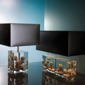 stylish modern table lamps with resin bases with pebbles and sleek black lampshades are bold and cool