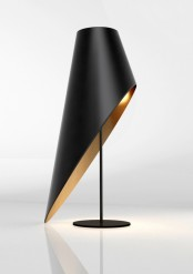 a gorgeous black and gold asymmetrical table lamp with a cut lampshade is a bold refined statement for a modern space