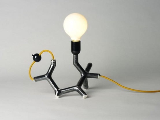 a fun chemistry-inspired table lamp in gold, black and with a bulb is a cool and catchy idea