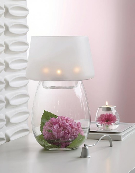 a romantic table lamp with a glass base - you can place anything inside, here there are blooms and greenery