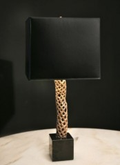 a refined black and gold table lamp with a sleek lampshade and a gold textural base to add a sophisticated touch to the space