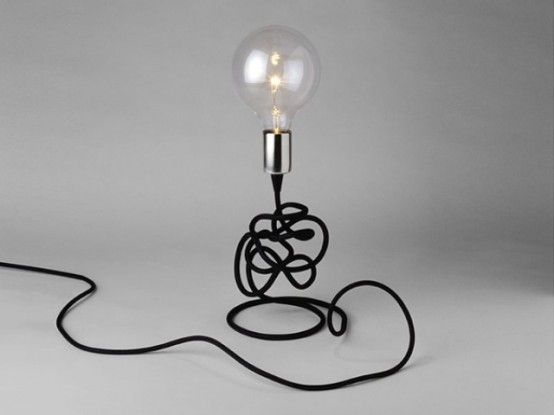 a stylish modern bulb table lamp with black cord is a cool idea for a contemporary space