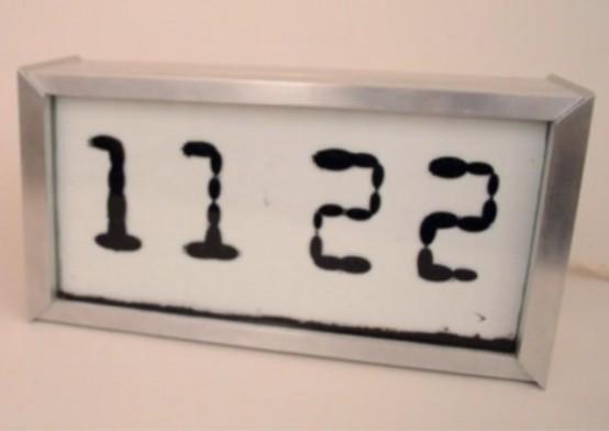 Unique Fluid Ferrolic Clock That Shows Time Flows