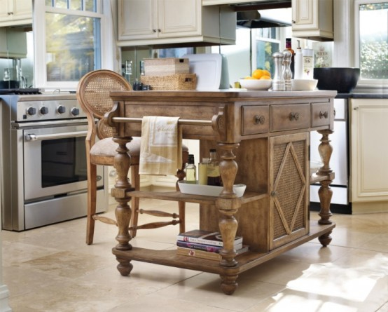 a super elegant carved and stained wood kitchen island with drawers and holders will bring a rustic and vintage feel to the space