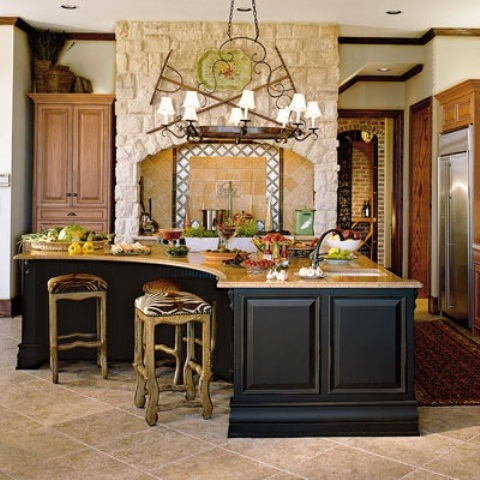 a black oversized and curved kitchen island with a wooden countertop is enough for cooking and eating