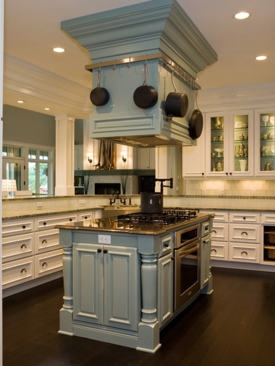a unique pale blue two part kitchen island with a stained wooden countertop, an integrated cooker and some hanging pans on the upper part
