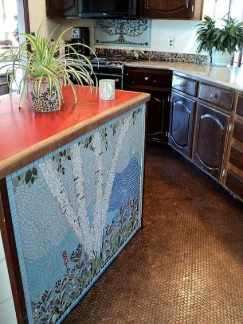 a colorful mosaic kitchen island with a bright countertop and a beautiful patterned base looks very artistic