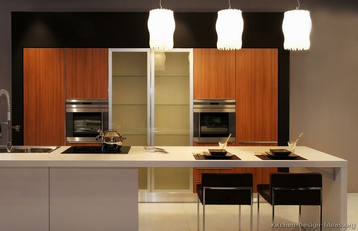 a neutral minimalist kitchen island with a white countertop, a cooker, a sink and an eating space