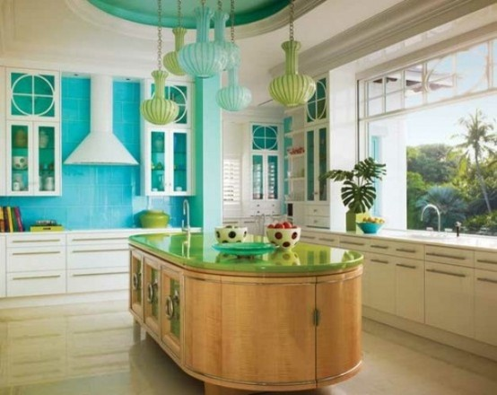 a stained wood curved kitchen island with much storage space and a green countertop stands out with its color and shape