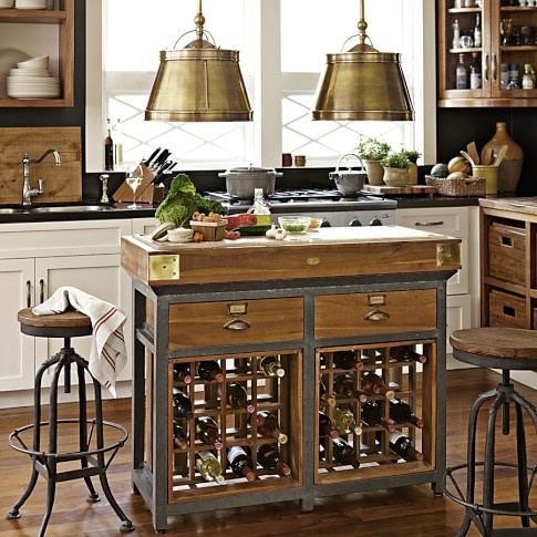 a small metal and wood kitchen island with drawers and wine racks inside is a very space-effective piece