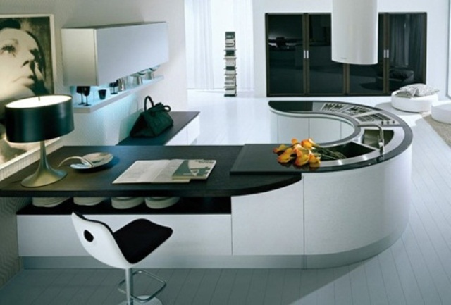 a minimalist oversized kitchen island in white and black separates the kitchen from the rest of the house