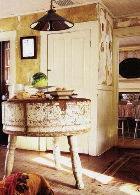 a small shabby chic round kitchen island with carved legs is a simple and casual idea for a shabby space