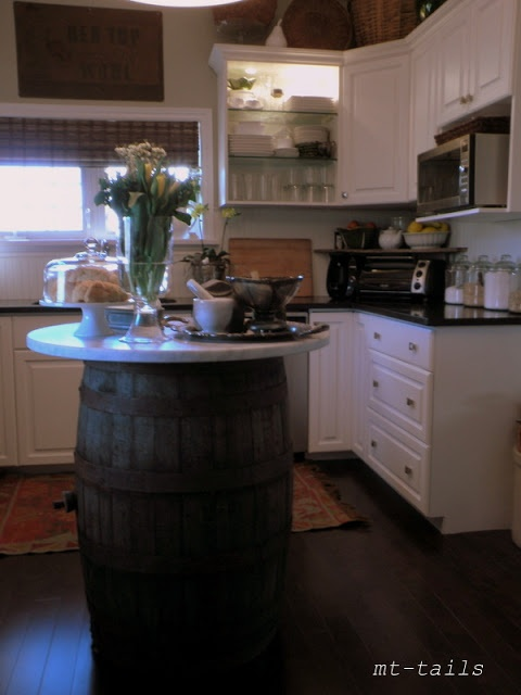 a creative kitchen island made of a barrel and a tabletop is unusual and simple to make