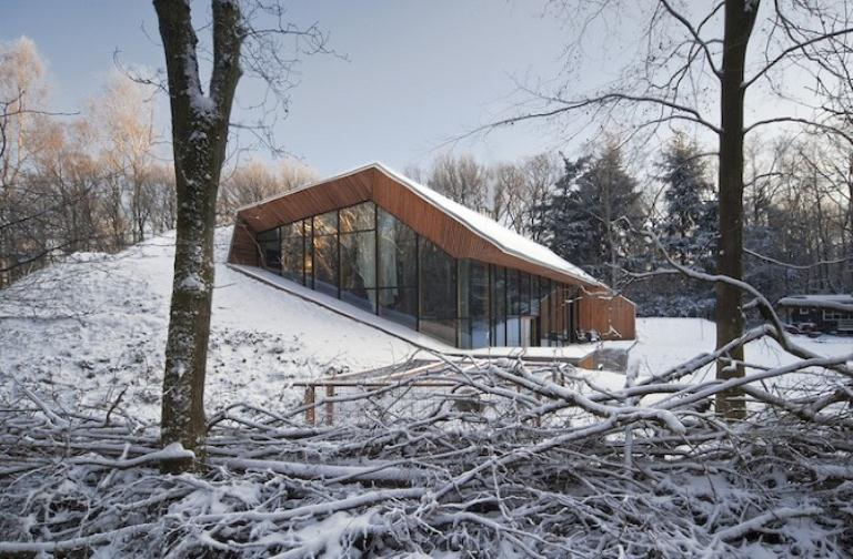 Unusual house built inside a hill digsdigs for Mountain modern architecture