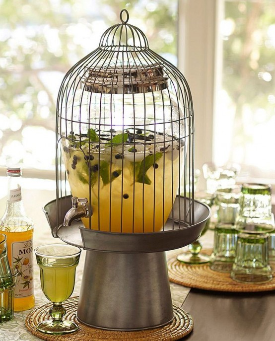 Turning a cage into a punch station is great idea for a summer party.