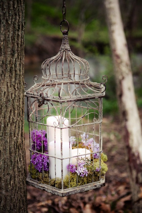 Put some moss, flower petals and candles into a bird cage and it'd become an awesome hanging or standing centerpieces.